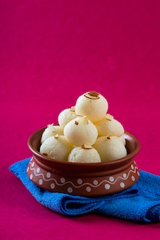 Indian sweet - rasgulla, famous bengali sweet in clay bowl with napkin