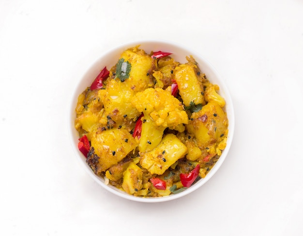 Indian traditional cuisine, gobi aloo vegetarian vegetable dish on white