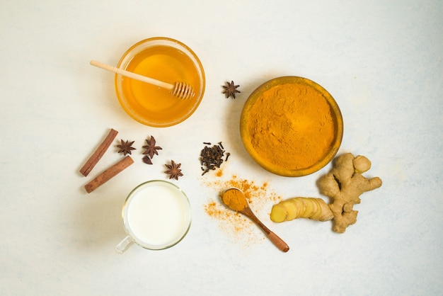Indian traditional golden milk with turmeric, ginger, spices, honey.