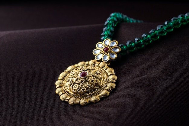 Indian traditional jewellery, close up of pendent on dark space