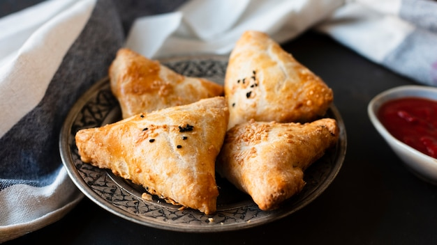 Indian traditional patisserie with sauce