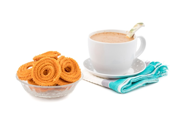 Indian traditional snack chakli, a spiral shaped crisp deep fried snack