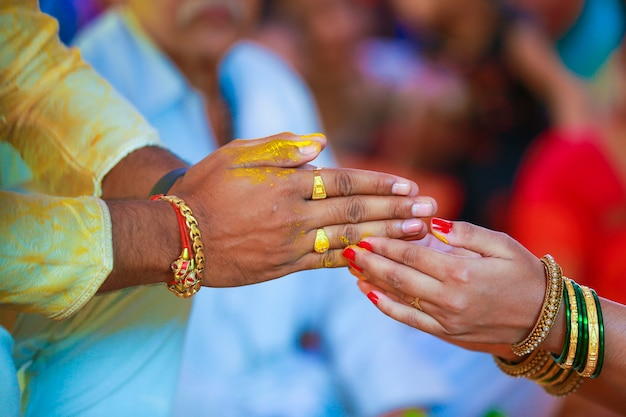 Indian traditional wedding groom hand in haldi ceremony