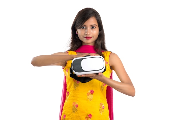 Indian traditional young girl holding and showing vr device