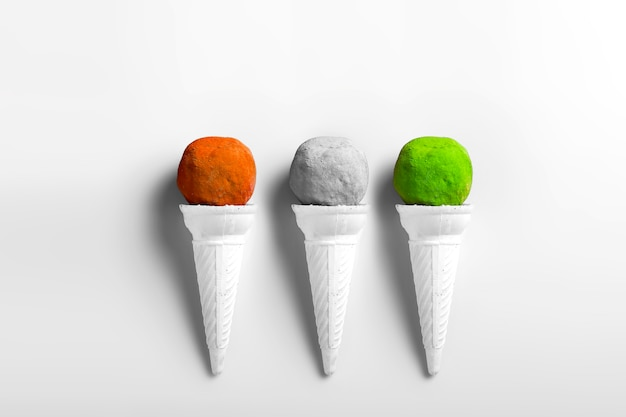 Indian tricolors in shapes of ice cream scoops in cones for indian holi festival or republic day concept
