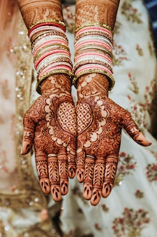 Indian wedding bangles and mehandi henna coloured hands with reflective ornament