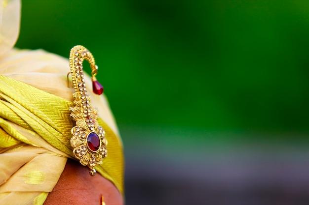 Indian wedding ceremonial. luxury oriental fashion beauty accessories: bridal pagadi