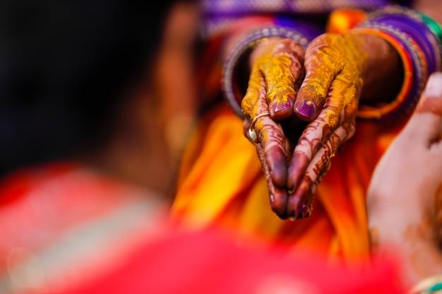 Indian wedding ceremony: bridal hand in haldi ceremony