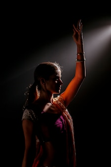 Indian woman dancing with the light