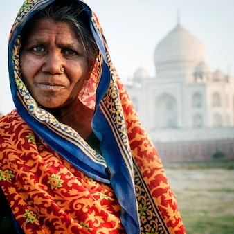 Indian woman in front of the taj mahal