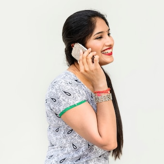 Indian woman is talking on the phone
