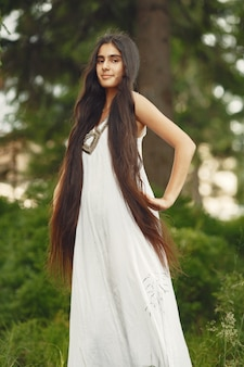 Indian woman with long hair. lady in a blue dress. girl with untouched nature.