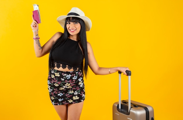 Indian woman with travel suitcase yellow space