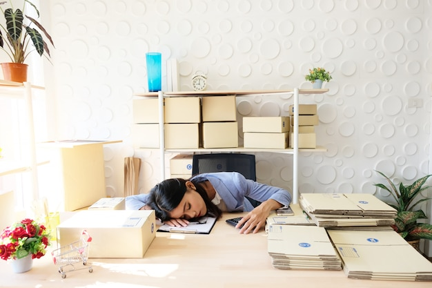Indian women are tired to sleep on the table.