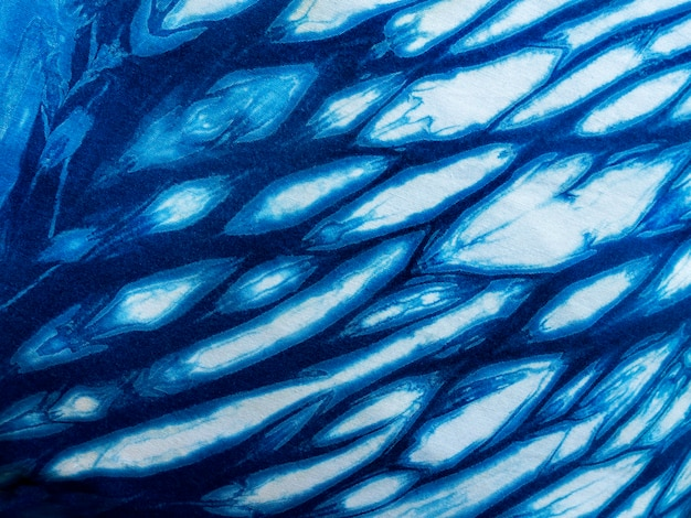 Indigo blue fabric tie dye pattern background. indigo-dyed fabric texture with abstract ethnic graphic motif pattern.