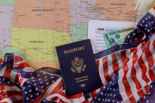 Individual income tax date time return form 1040 u.s. and american passport on u.s. map