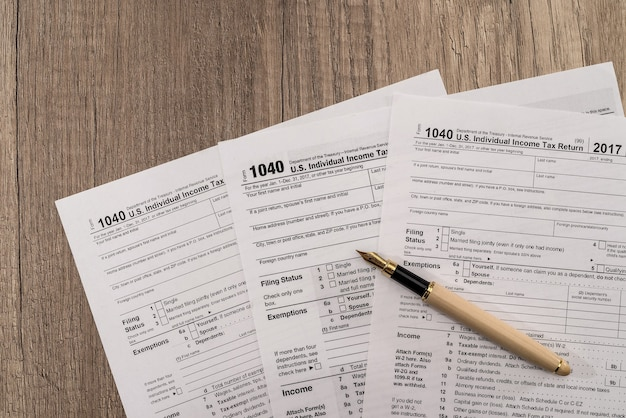 Individual tax form 1040 with pen and glasses