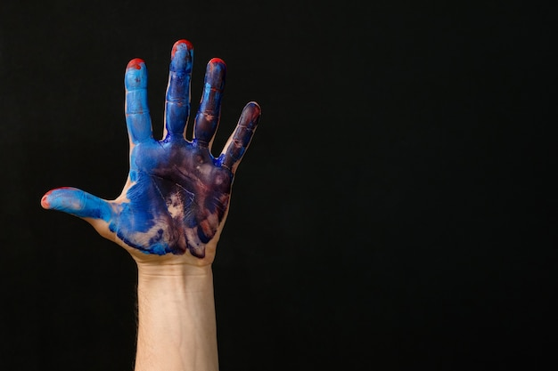 Individuality and identity. hand smeared with red blue paint. art hobby lifestyle occupation. creative activity and therapy.