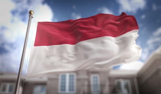 Indonesia flag 3d rendering on blue sky building background