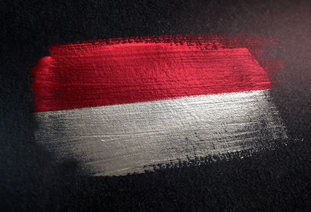 Indonesia flag made of metallic brush paint on grunge dark wall