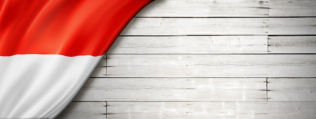 Indonesia flag on old white wall. horizontal panoramic banner.