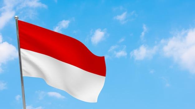 ポールにインドネシアの旗。青空。インドネシアの国旗