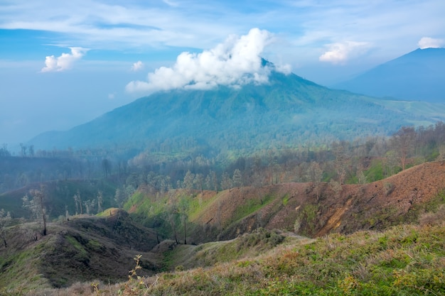 Indonesia. java island. morning. clouds in the blue sky near the crater of the volcano