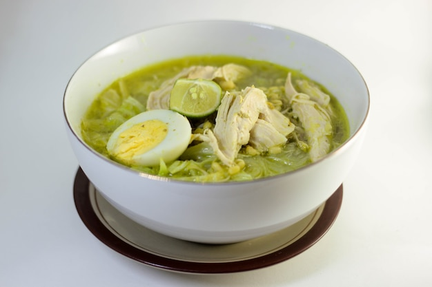 Indonesian chicken soup with fresh gravy and lime juice