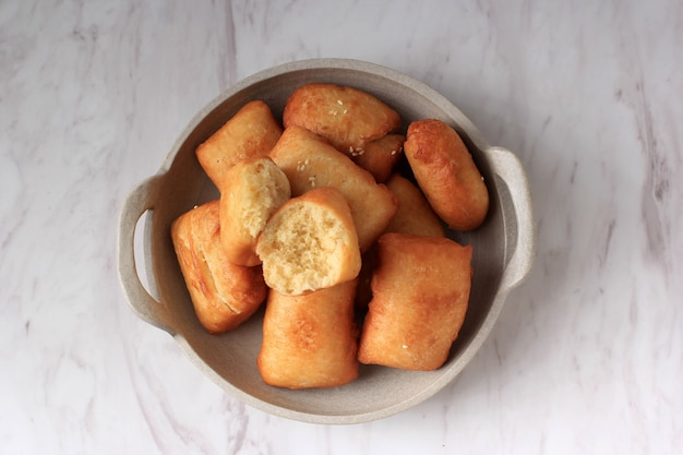 Indonesian fried bread called roti/kue bantal or famous name odading, selected focus