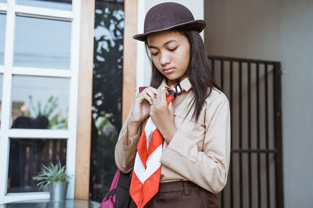 Indonesian girl scout getting ready to go