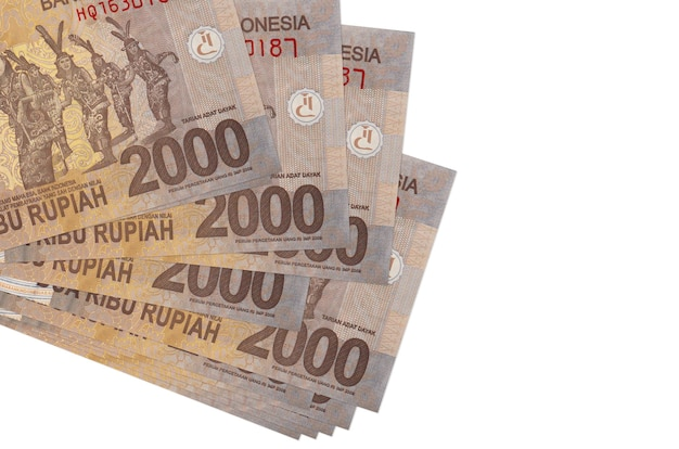 Indonesian rupiah bills laying in small bunch or pack on white surface