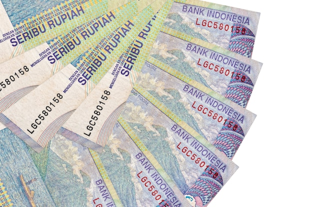 Indonesian rupiah bills lies isolated on white background