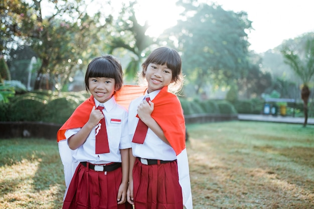 Indonesian school student holding flag during independence day