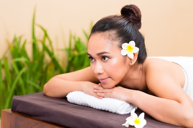 Indonesian woman in wellness day spa