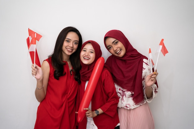 Indonesian woman with flag celebrating independence day