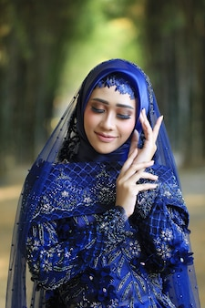 Indonesian women wear traditional muslim bridal clothing in outdoor