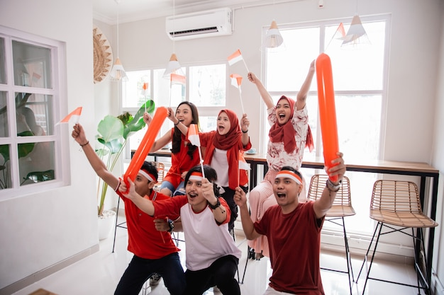 Indonesian youth celebrating national independence day wearing red and white