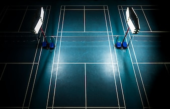 Indoor badminton court with bright white lights