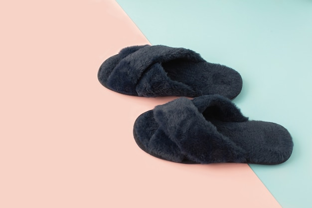 Indoor blue home cozy slippers on a color desk