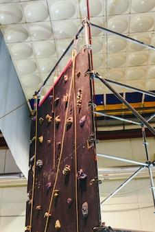 Indoor climbing wall for children during a fair.
