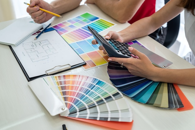 Indoor interior colours choosing by designers on their workplace .