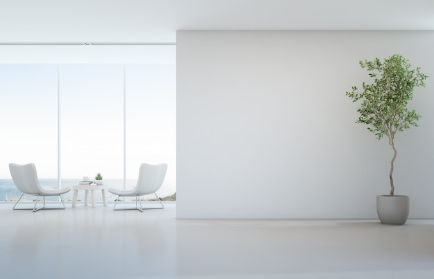 Indoor plant on white floor with empty concrete wall