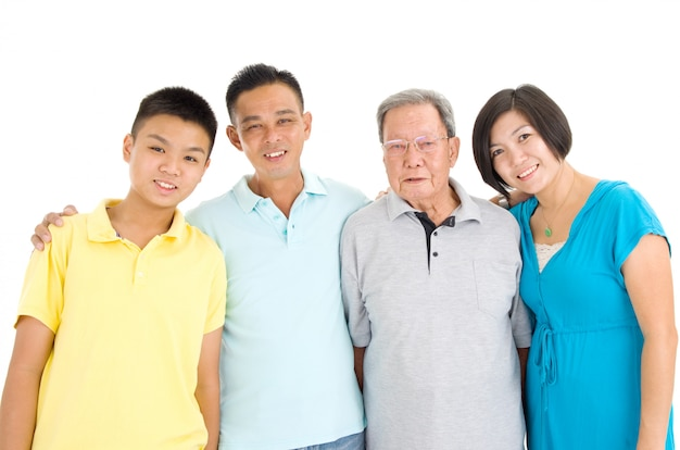 Indoor portrait of beautiful asian 3 generations family over white background