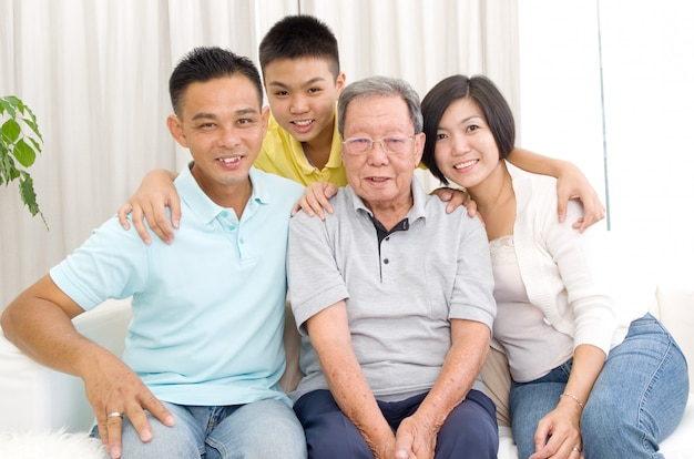 Indoor portrait of beautiful asian 3 generations family