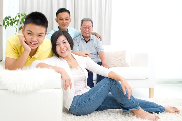Indoor portrait of beautiful asian 3 generations family