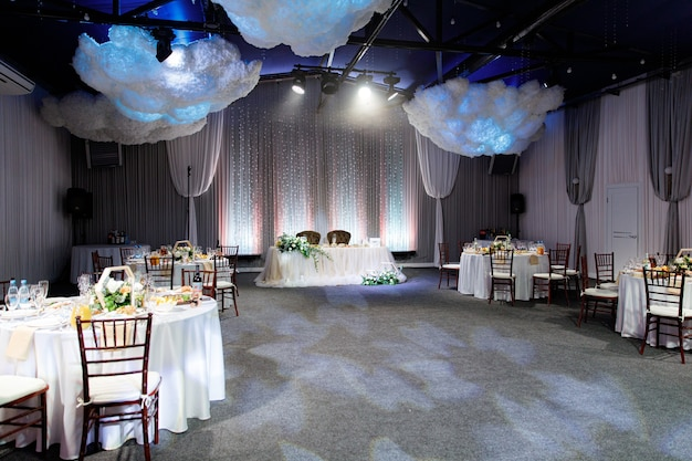 Indoor room with tables for a banquet or wedding