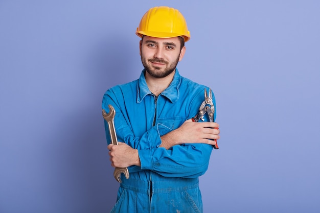 Indoor shot of bearded worker looking directly at camera