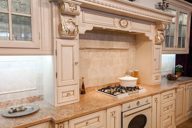 Indoor shot of classic luxury kitchen in beige color
