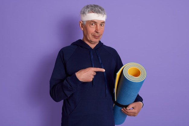 Indoor shot of elderly man wearing sport clothing