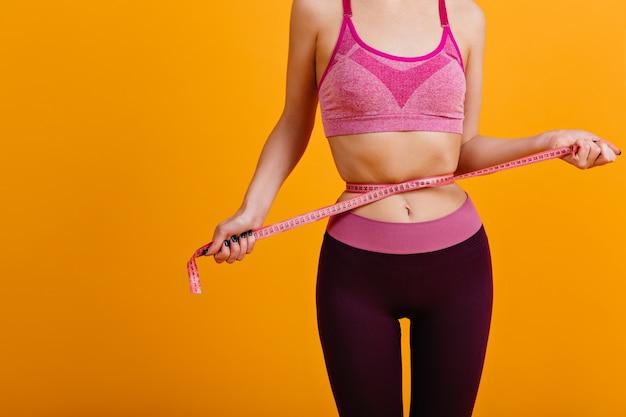 Indoor shot of woman in good shape after diet